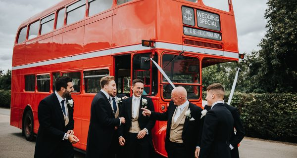 Vintage red london bus at a barn wedding