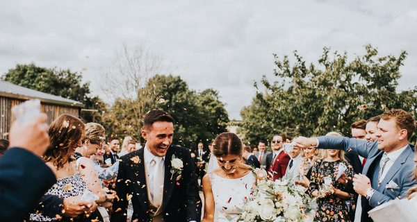 Bride and Grrom confetti shot after outdoor wedding ceremony