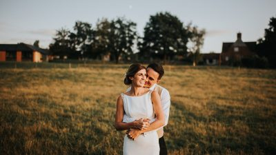 Happy bride and groom in a field